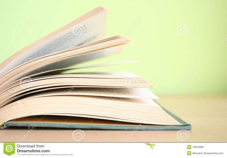 An open book with green background