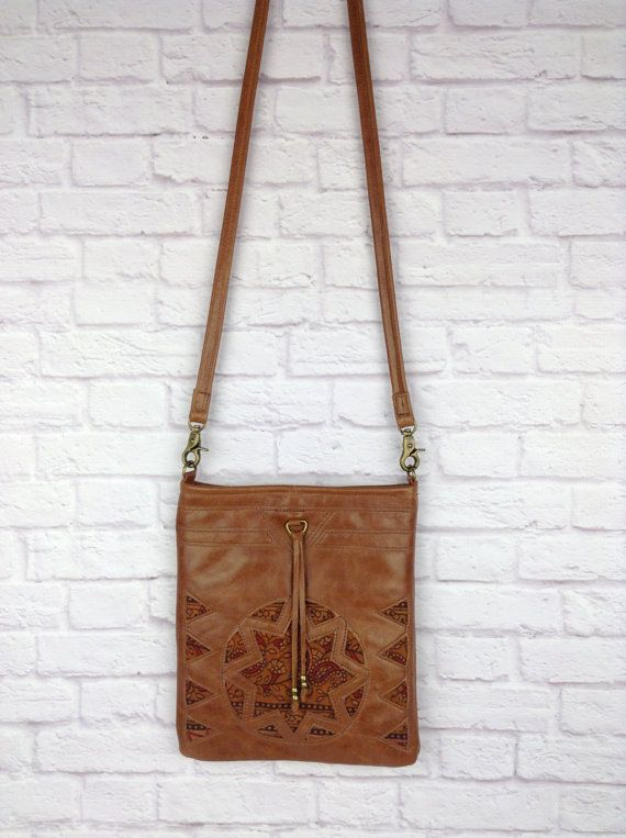 handmade leather cross body bag with beaded tassel by Wolf Blossom
