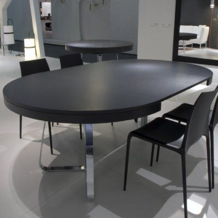 The Ava Extending Dining table design by Thibault Desombre in 2010. A sibling to the Craft table, it has a integral fold-out extension leaf which tranforms a 6 seater, 130cm dia table into a 10 seater, 217cm oval or Rectangular dining table. Base in chrome with Walnut veneer or White, Argile, Elephant coloured top.