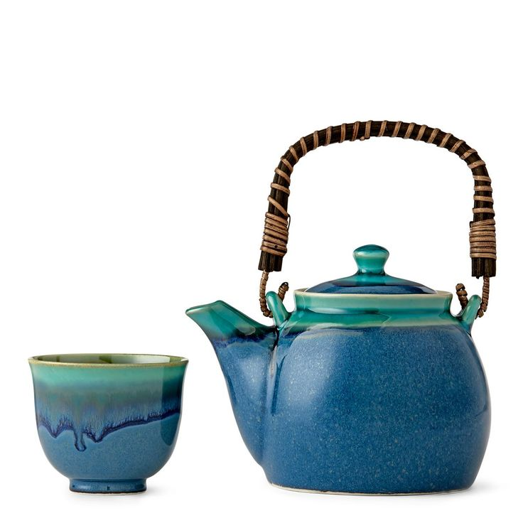 Reminiscent of tranquil tropical beaches, this two-tone glazed tea service fuses traditional teapot shapes with modern glazing techniques for an updated tea set style.