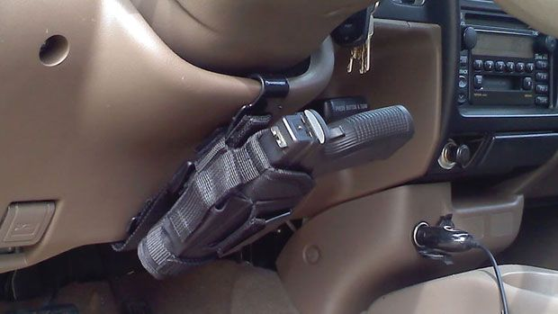 Universal Vehicle Holster Mount  Danger usually comes when you least expect it. And if you happen to have yourself aDouble Barrel Pistolfor self-defense, it's not going to do you much good locked away in the glove department, or worse, the trunk.
