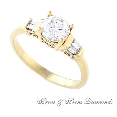 Centre diamond is a 0.937 I/SI1 Round brilliant cut diamond with 4 x baguette cut diamonds set in 18k yellow gold