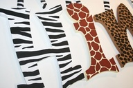 We would have animal print lettering in front of our ice cream parlor, because many of Barceló's works are african.  This will catch customers eye when driving past our parlor, and possibly bring us more business. Our shop has an African theme.  (African Paintings our displayed on the board.)