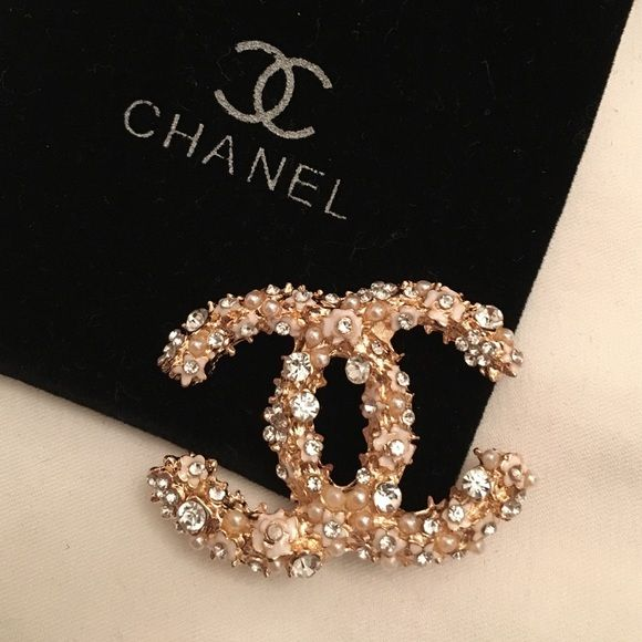 Chanel brooch Be among the first in the world to wear this stunning CHANEL brooch with gold color edges. Elegant size.   From daily wear to entertaining and weddings. Can be used on your jacket, sweater, hat, belt, bag, scarf, etc.   Very glamorous and sophisticated!    Nice gift for yourself!  This CHANEL pin brooch, brand new, and unused. And in perfect condition as all CHANEL items. CHANEL Jewelry Brooches