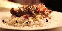 Slow cooked lamb with fetta and tomatoes, pilaf and fatoush salad