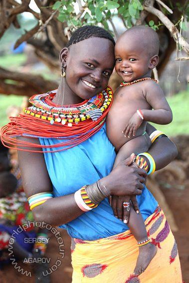 Africa | Portrait of a Samburu women wearing beaded jewelry and carrying her child, Kenya | © Sergey Agapov #beads #collar #maternal #love