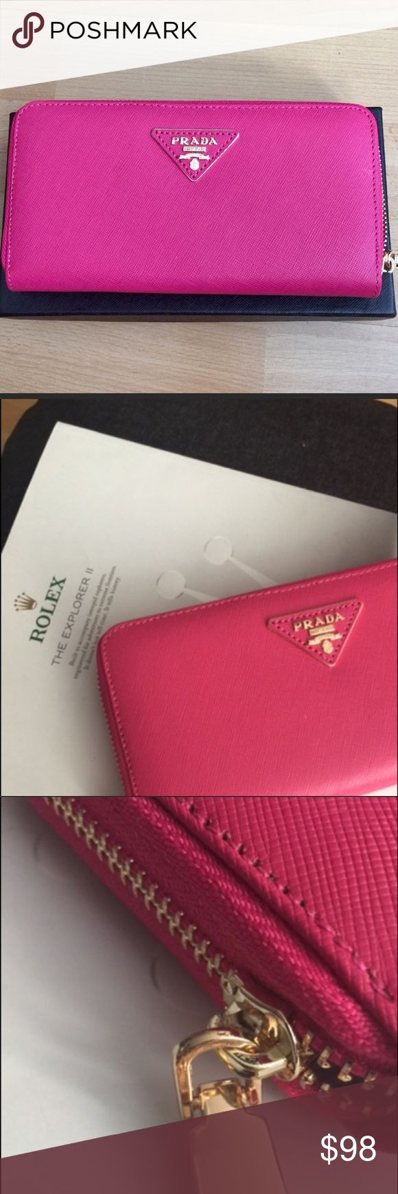 "💄Hot Pink Designer Zip Around Wallet 💄 Gorgeous designer long Saffiano wallet with golden hardware. Purchased on M & been sitting in drawer ever since. Too pretty not to be used😍❤️😍Brand for Exposure👍🏻offers considered! Plz do NOT ask the obvious... Price reflective TY 😘 Zip-around wallet. Interior zip pocket. Eight credit card slots. Two billfold pockets. Interior zip change pocket. 4 1/4""H x 7 1/2""W x 3/4""D; Made in Italy. perfect! Prada Bags Wallets"
