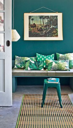 Easy and cheap way to get old colonial decor feel- Old print, rich wall color, straw mat, tropical pillows