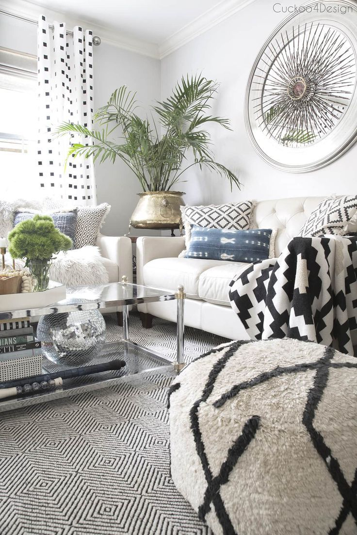 neutral eclectic living room with black and white accents | neutral eclectic living room with blue accents | shibori pillows | jeans pillows | black and white accents | mixing metals |