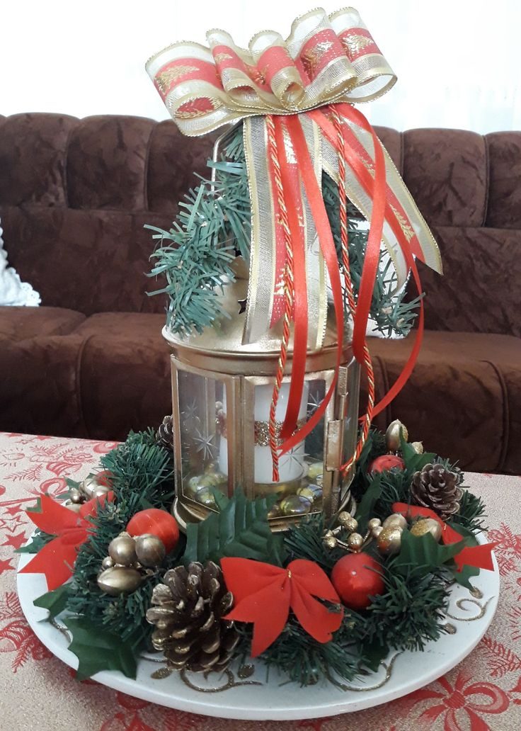 DIY Christmas centrepiece  with gold lantern and a decorated wreath.