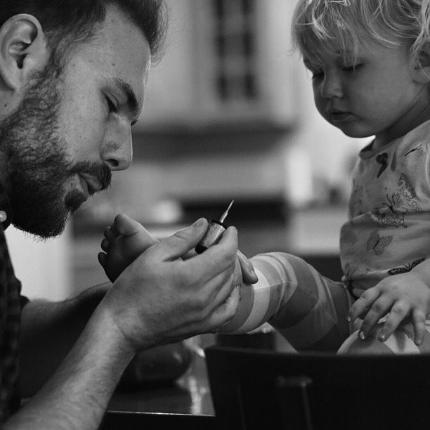 """A dedicated Dad will patiently paint her toenails so that she can look pretty """"just like Mommy""""."""