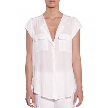 Mela Purdie Pocket Blouse - Mousseline This utilitarian blouse has a round neck and a small opening tab at the neckline. Featuring two small pockets and short cropped sleeves it is the perfect loose slim fitting silhouette for summer.