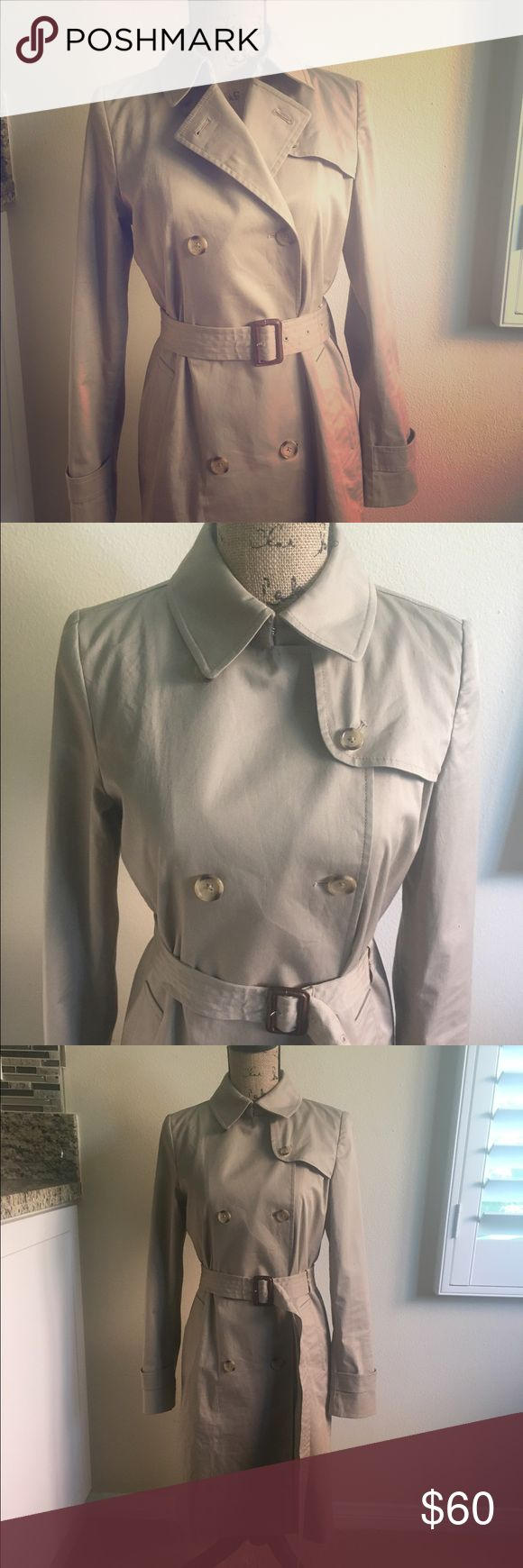 Versatile Tan trench coat Worn once! Excellent condition! Front buttons and adjusts in many ways. Length to the knee. Uniqlo Jackets & Coats Trench Coats