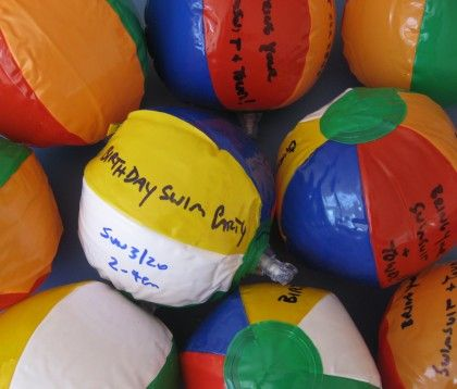 Pool or Beach Party Invitations ~ write the information on mini beach balls with a Sharpie. When deflated, they fit perfectly in a standard envelope