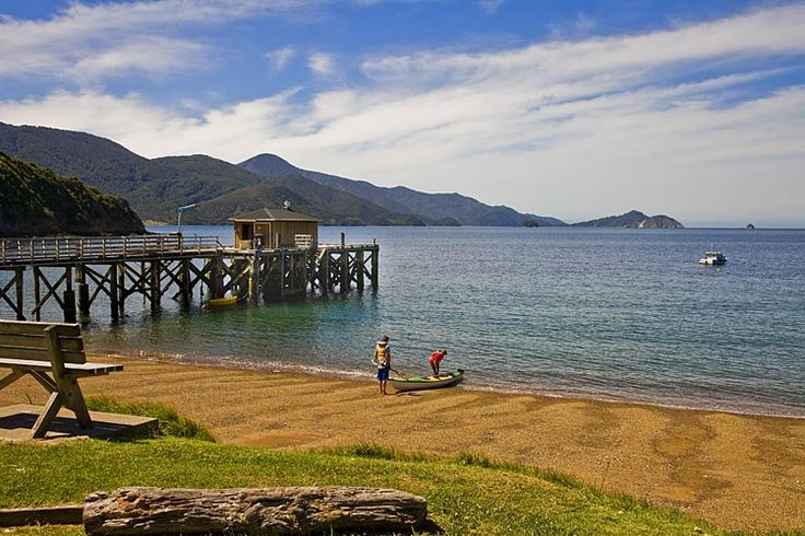 French Pass, wharf, boys with canoe,  see more at New Zealand Journeys app for iPad www.gopix.co.nz