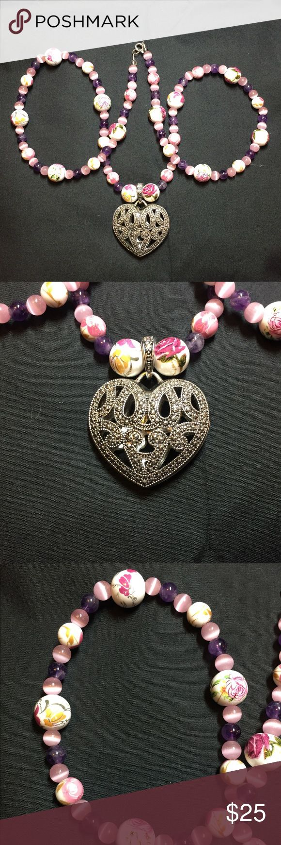 Handmade Pink Purple Stones Heart Pendant Necklace Beautiful! Simple yet elegant!  This is a handmade necklace made of pink cats eye stone beads, amethyst stone beads, porcelain beads with painted flowers, and a gorgeous heart pendant! The necklace is 15.5 in length. Handmade Jewelry Necklaces