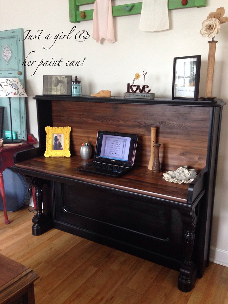 This is a piano that my friend Cory's wood creation did.  He gutted it and made it into a study desk.