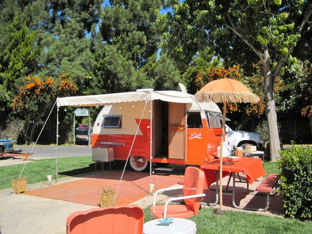 What a cutie orange camper