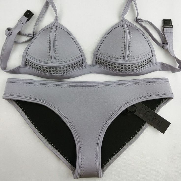 You know you want me, Just BUY ME already! This neoprene bikini features a solid tone that makes it fun and flirty to wear. - Made of Neoprene - Spaghetti Strap Bikini Top - Unpadded and Wire Free for