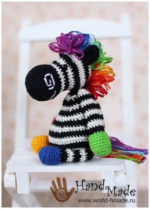 Zebra Berta with a rainbow mane. Free crochet pattern.