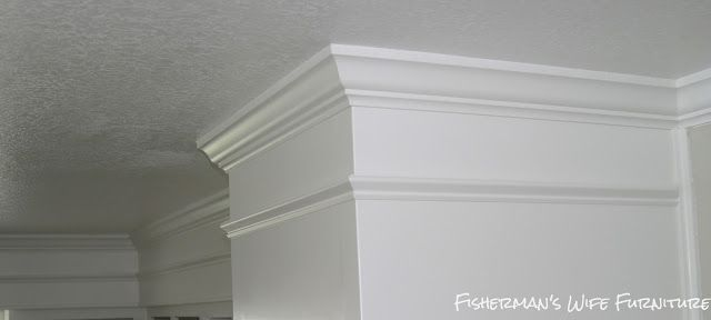 Wow.  covering the soffit to make it look like extended cabinets to the ceiling in the kitchen.  Wow.