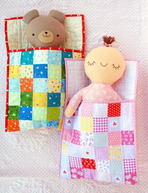 Baby and Teddy's happy faces show that they love to play. When they're tired, flip them over, and their face shows that they're sleepy! Time to sing them a lullaby and slip them into bed. Bed measures 30cm x 42.5cm (12in x 17in)