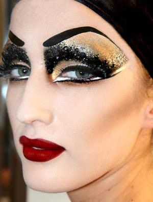 too much, but the winged eyeliner with white highlight is a great look if you can pull it off. Good example of cheek contour.