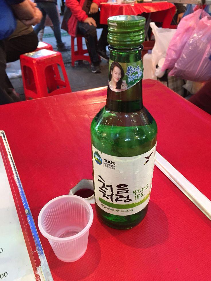 Drinking some soju at Namdaemun market, Seoul, South Korea.