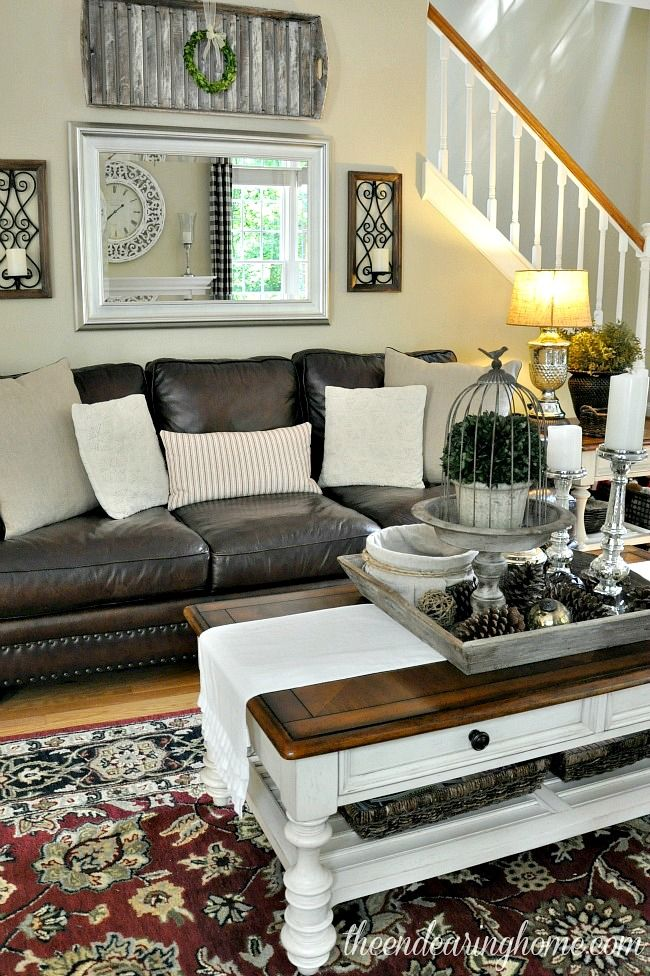 White and silver framed mirror ties in with all the silver accesories so nicely!!! Family Room - The Endearing Home