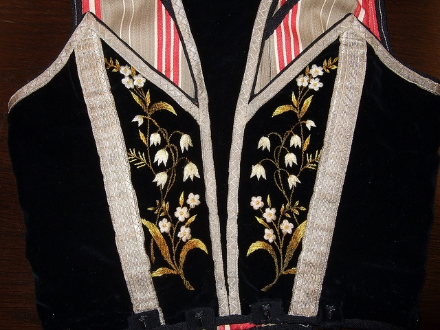 back of woman's bodice embroidered with lily of the valley. Detail from old Norwegian national costumes. The collection of Rikard Berge and from the exebition at Seljord of old costumes from Telemark county, Norway