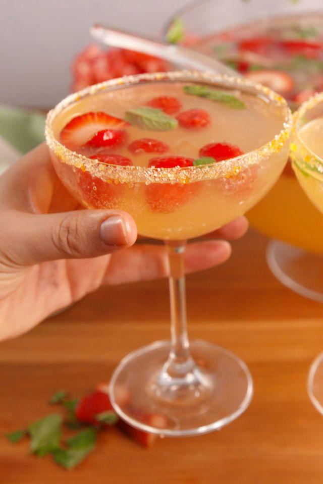 Brunch Punch (serves 25) -Ingredients: Ice, 2L sprite, 2c. orange juice, 2 c. pineapple juice. 2 c. vodka, 1 bottle prosecco, 2c. Strawberries sliced, 2c. raspberries, 1c. fresh mint leaves (+1c for garnish), sanding sugars for rims.