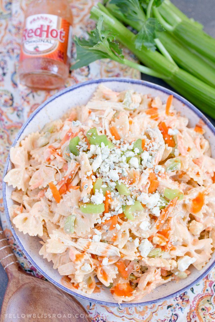 Buffalo Chicken Pasta Salad - Ranch dressing, blue cheese & buffalo sauce with pasta, chicken, celery & carrots. Great for summer parties and fall tailgaiting.