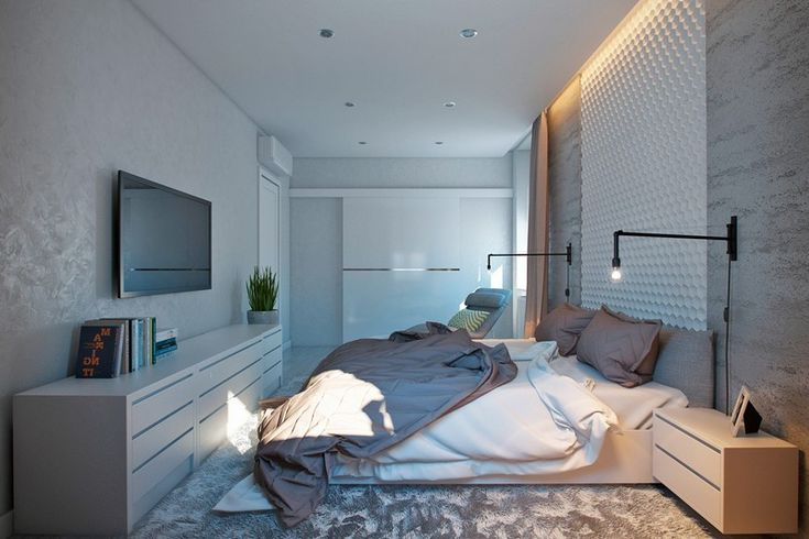 Modernes Schlafzimmer mit weißer Wand und grauem Shaggy-Teppich