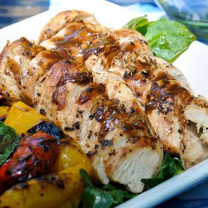 Chicken breasts, marinated in lemon and black pepper, and grilled to perfection -- it's a summertime classic.