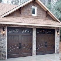 Love the rod iron windows on the garage doors