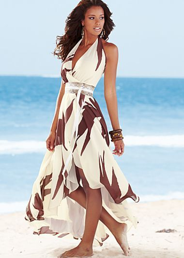 """Off White Multi (OWMU) Belted Print Maxi $79   Fall in love with summer again!   A faux python belt accents this two layer wrapped dress.  Surplice style with halter neckline    Elastic waistband, side closure    42"""" in length from natural waist    100% Polyester ; lining: 100% polyester; Imported    Style #Z39043"""