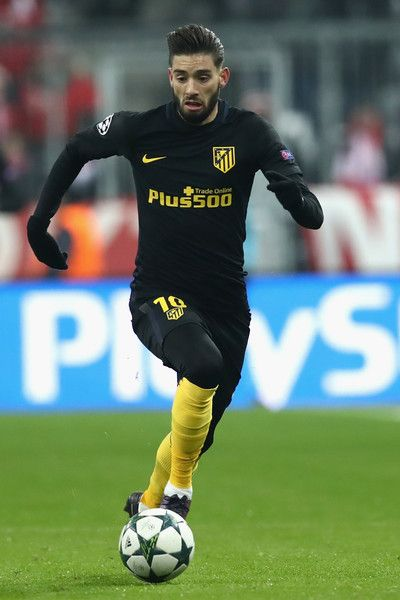 Yannick Carrasco of Atletico runs with the ball during the UEFA Champions League match between FC Bayern Muenchen and Club Atletico de Madrid at Allianz Arena on December 6, 2016 in Munich, Bavaria.