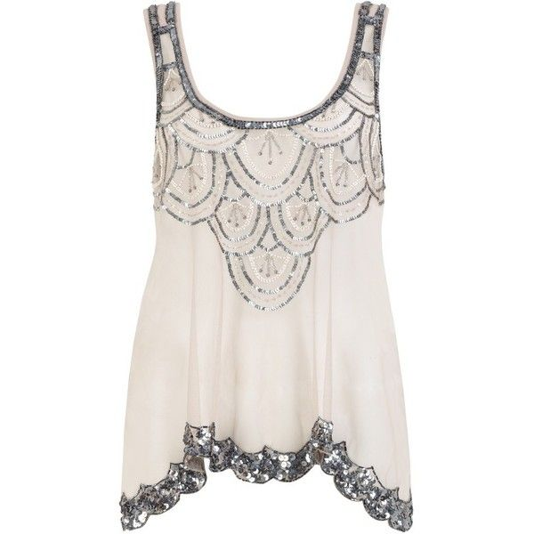 I just love how feminine this top is, and with skinny black pants and flats I might be able to pull it off as a night out look. Or an evening in- just because I LOVE THIS!