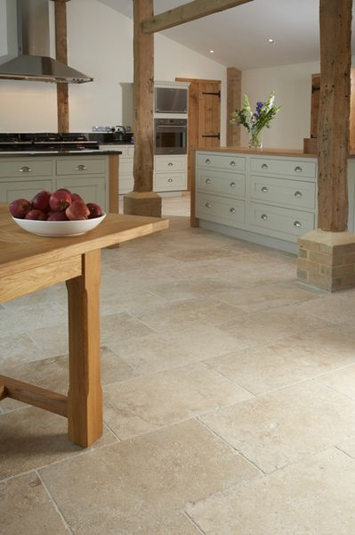 contemporary country barn conversion kitchen with Tumbled Aspendos Travertine floor tiles