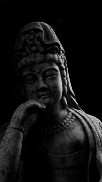 Stone statue at Hokoku-ji temple, Kamakura, Japan 報国寺 鎌倉