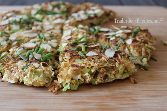 Known to some as Japanese pizza, this is a simple okonomiyaki recipe. Egg-battered shredded cabbage and leeks are cooked in a skillet until golden; then served cut into wedges and sprinkled with Trader Joe's toasted almonds and chives.