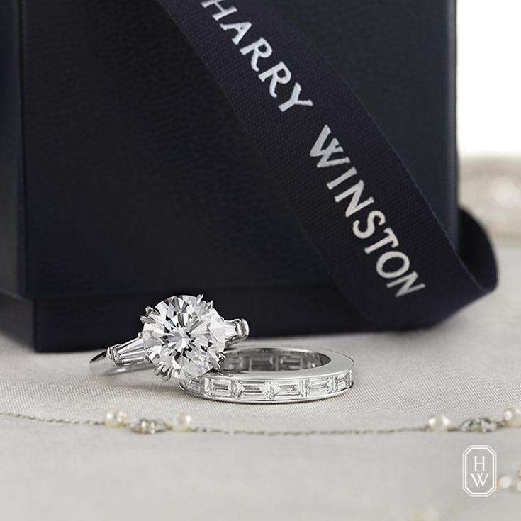 Present her with the timeless elegance of the Classic Winston Round Brilliant Diamond Engagement Ring. #FindTheOne #HarryWinston