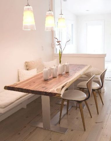 Dining nook with banquet and rustic light wood table