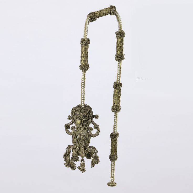 Long cord of alternating beadwork and knotted and braided work, terminating in an urn-shaped tassel heavily studded with glass stones. Italy, late 16th - early 17th century.