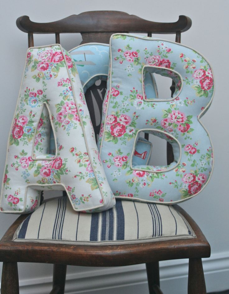 Alphabetty Letter Cushions Pillows - Cath Kidston fabrics. via Etsy.    I think I'll make something similar...