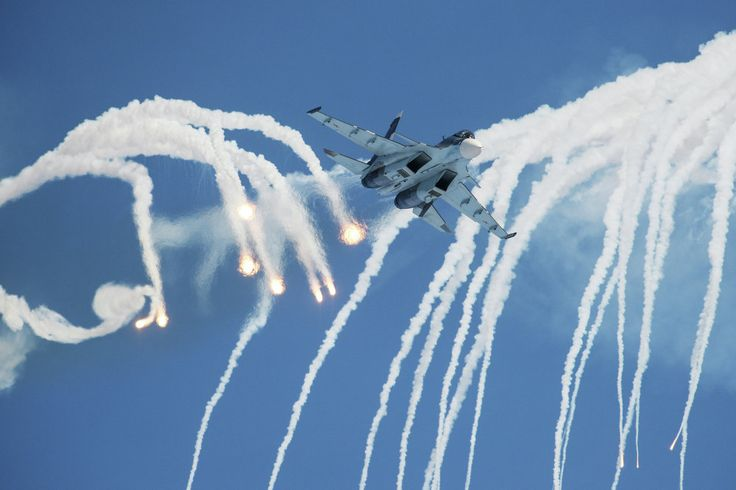 """The reform envisions a significant downsizing of the armed forces, a reduction of the number of conscripts and an increase in the number of professional soldiers. A Su-30 fighter jet of the Russian Falcons aerobatics team flies during an air show as part of the """"Professional military service is your choice!"""" campaign. A large-scale event promoting professional service in the Russian Armed Forces was held in Barnaul on January 24."""