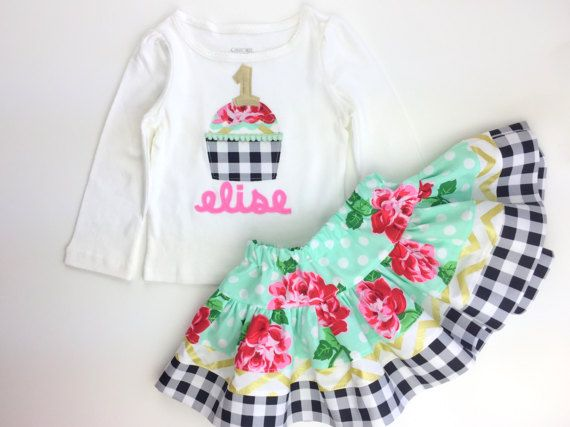 This set is perfect for your little ones first birthday. The adorable cupcake is appliqued on the shirt with your childs name and age. The applique is hand drawn and cut, and it is machine stitched. It is paired with our signature EXTRA FULL twirl skirt that is made out of high quality designer fabrics, it has a drop waist and over 80 inches of fabric gathered into it. 12-18m, 18-24m, 24M/2T, 3T, 4T, 5T *Please leave in your comments what size you would like and the initial or number d...