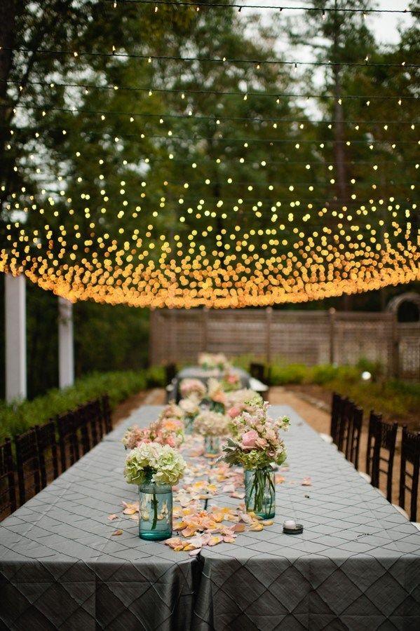 crisscross white lights over tables