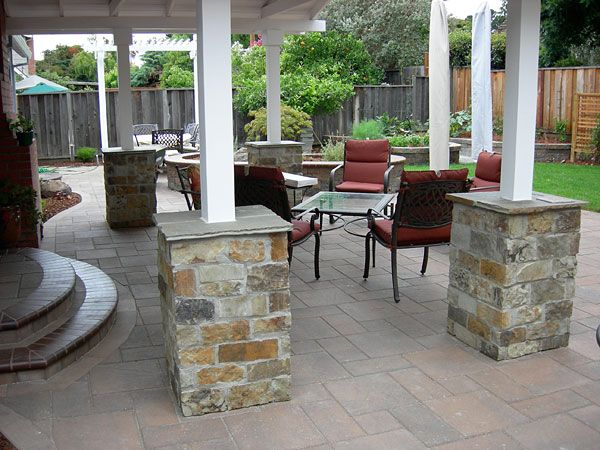 Natural Stone Pillars Dress Up The Patio And Provide Guests A Place To Rest  Their Glass