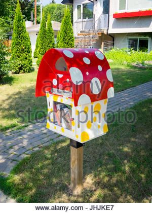 A cute Little Free Library book exchange box in Saskatoon, Saskatchewan, Canada. - Stock Photo